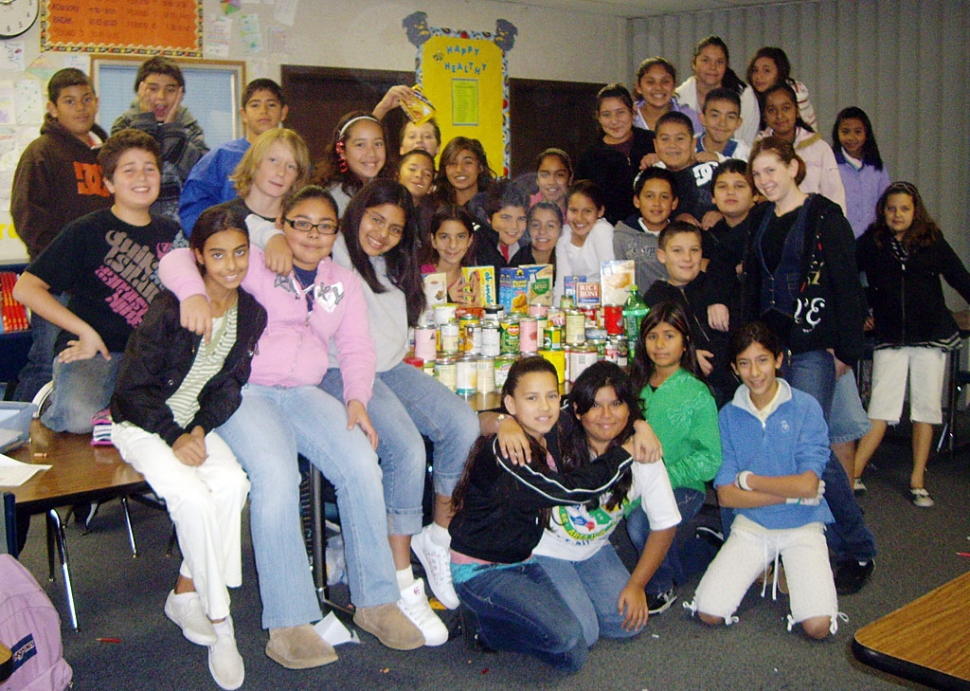 Fillmore Middle School AVID students gathered over 200 cans this Holiday Season! For two weeks the 6th, 7th, and 8th grade students had been competing to see which class could gather the most canned foods. This picture was taken of the 6th grade students, who brought in more than half of the total cans gathered for the food drive. All donation were given to Food Share, to feed the needy this Christmas. Thank you to all students and parents who contributed to this cause.