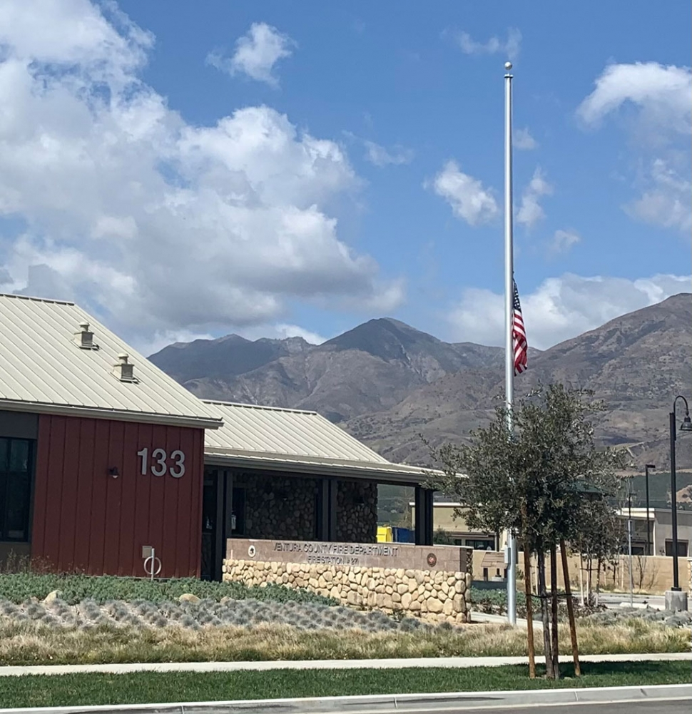 Fire station in Fillmore with flag at half-mast.