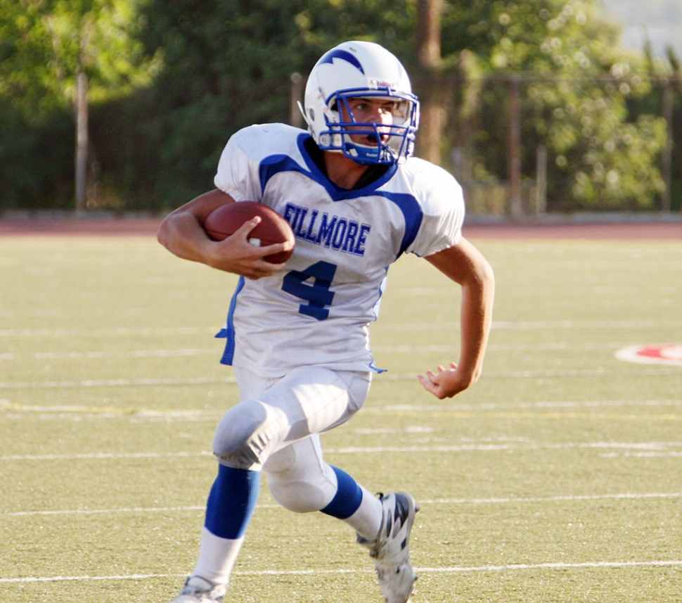 Collin Farrar #4 runs the ball for a touchdown. Sammy Orozco also had a touchdown. Fillmore won 21-16.