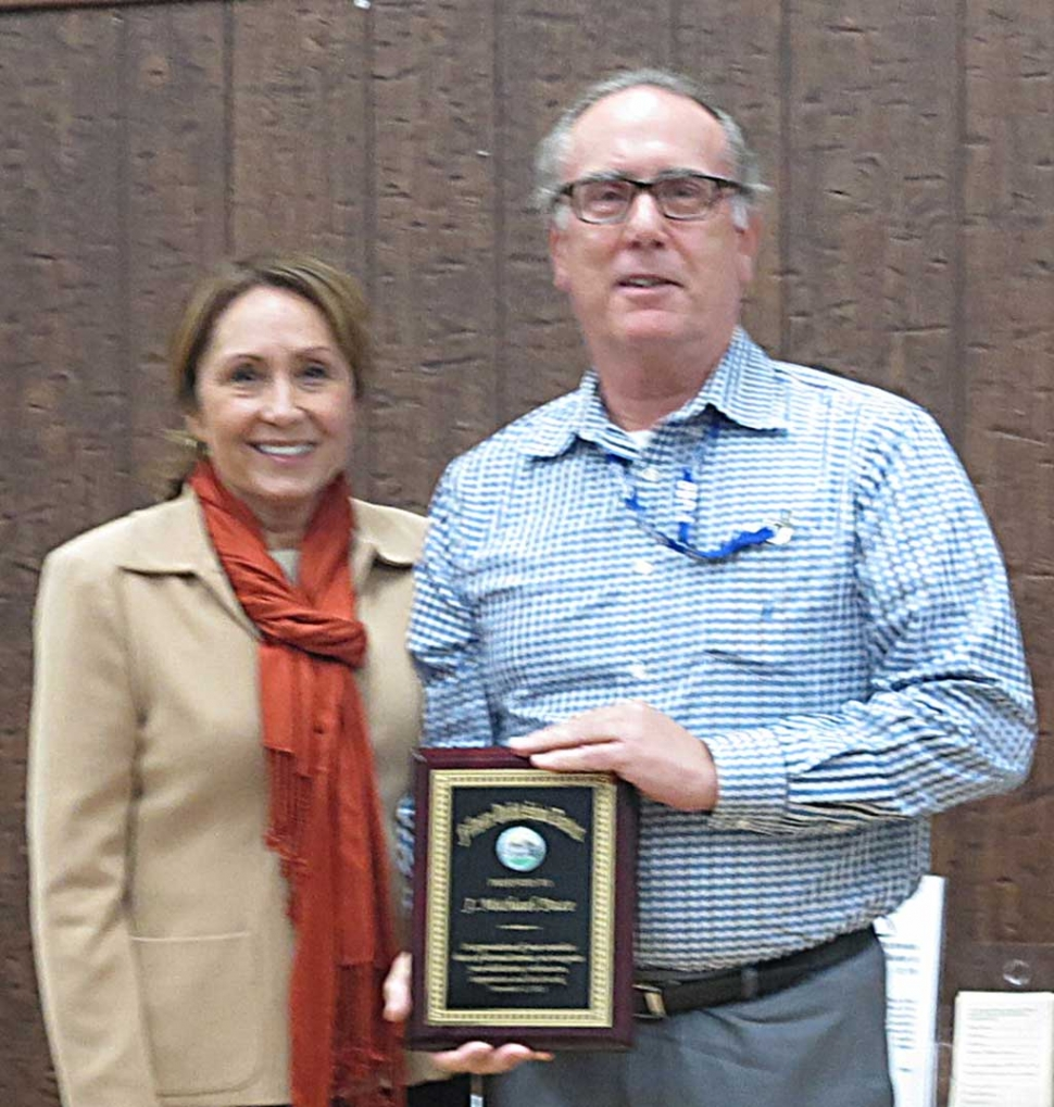 Mike Pace was recognized for his years of service to the Fillmore Unified School District. He will be leaving the district at the end of November. School Board President Virginia De la Piedra presented the plaque.