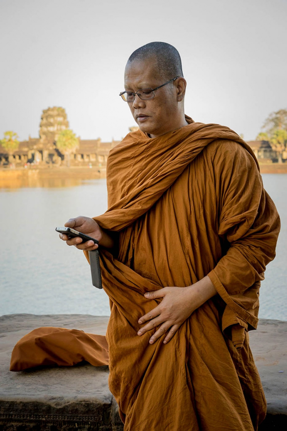 Monk, Cambodia. By Photographer Maureen Clark.