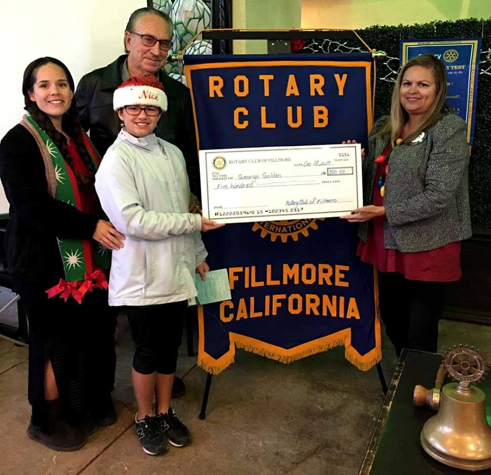 Pictured is Reverend George Golden, with the assistance of his family members, Vanessa and Hannah, joining Fillmore Rotary Club last week. Courtesy Martha Richardson.