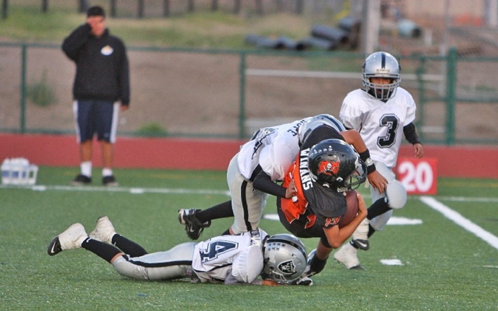 Chad Hope puts a big hit on a Ventura ball carrier.