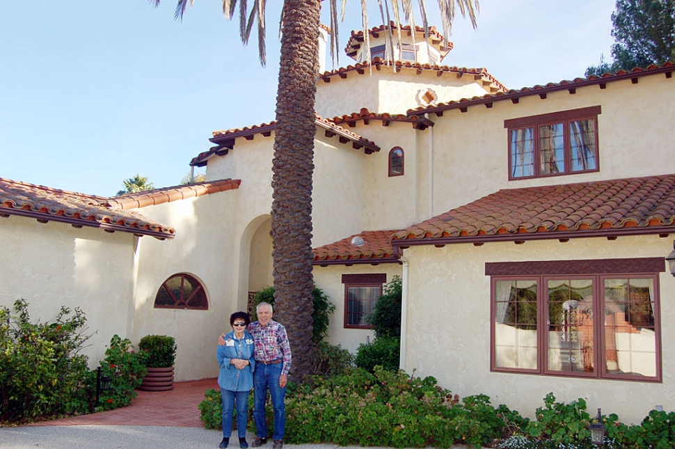 Esther and George Tamayo stand in front of their 8,000-square-foot house they built 19 years ago on Lingdooley Ranch in Santa Paula. Their home and barn are among four stops on the Barns, Ranches and Homes tour to benefit Santa Clara Vally Hospice on March 12, 2011.