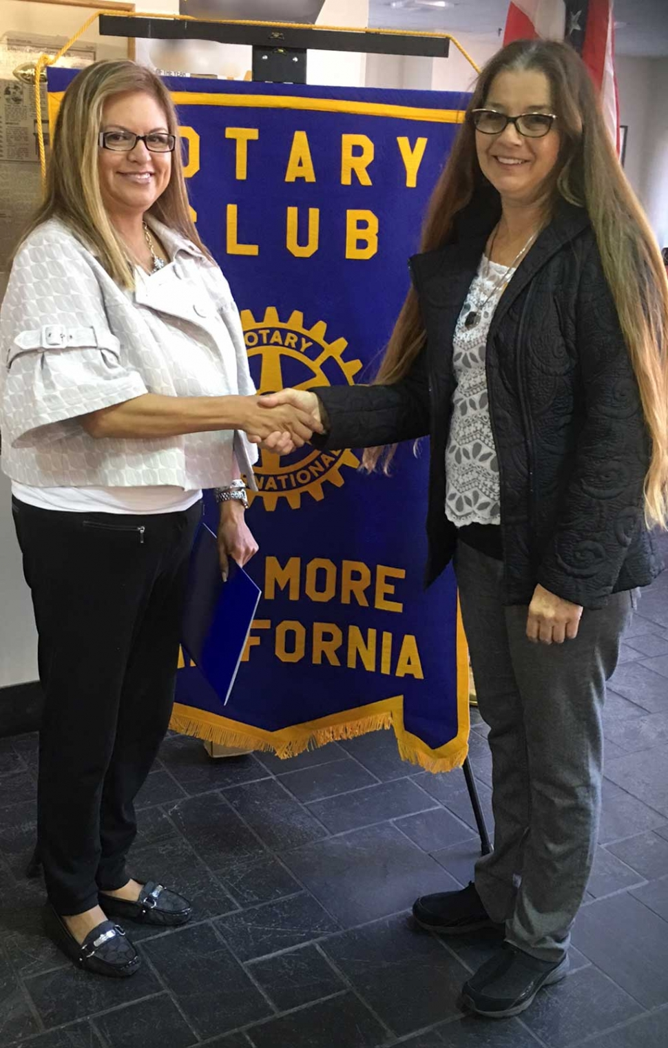 The newest member to the Rotary Club of Fillmore is Ari Larson inducted by President Julie Latshaw