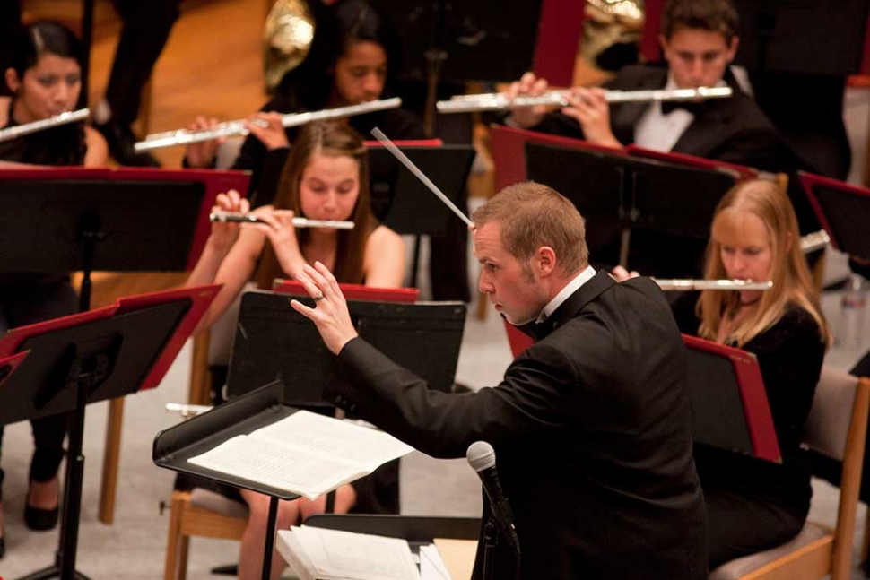 Michael Hart directing the Cal Lutheran Wind Ensemble. Photo credit: Brian Stethem