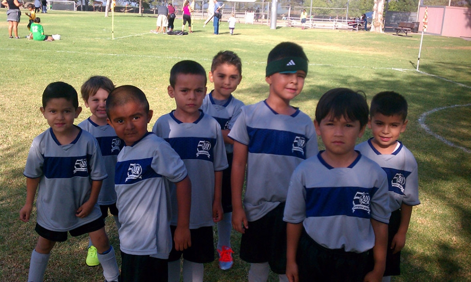 The U-6 blue ninjas boys getting ready for the start of the soccer game.