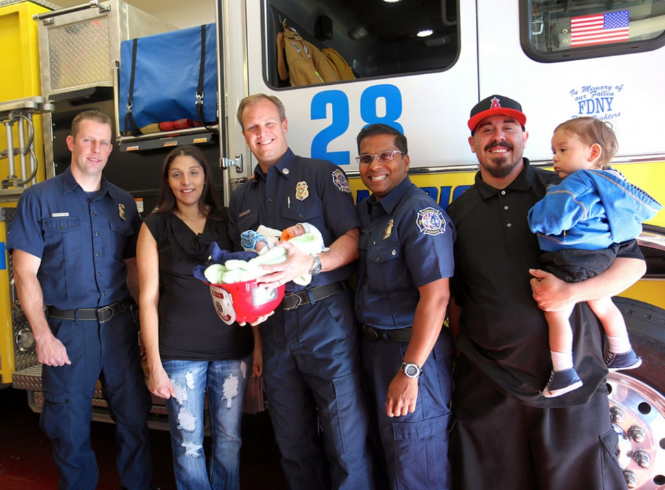 "Michael came into the world on March 22, 2014 – and he arrived in a hurry. His parents Vanessa and Brenden were in route to the hospital, but Michael wouldn't wait. VCFD dispatchers directed the couple to the closest fire station, Station 28 in Piru. Michael was born at 11:06 a.m. in the office at Station 28. Today, the entire family met the firefighters who delivered Michael and watched as they were awarded with ""stork"" pins signifying they had delivered a baby. Everyone at the Ventura County Fire Department wishes Michael a long, happy, healthy life. Photos courtesy Sebastian Ramirez."