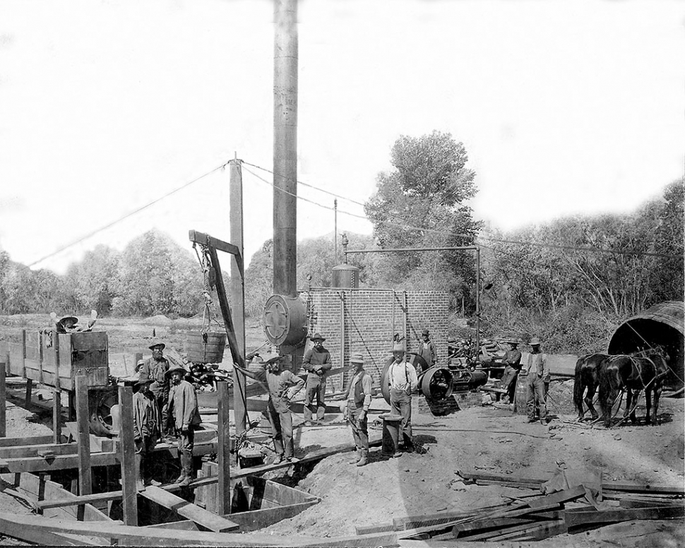 Men drilling the first water well on the Stringtown Ditch at Shiells Canyon.