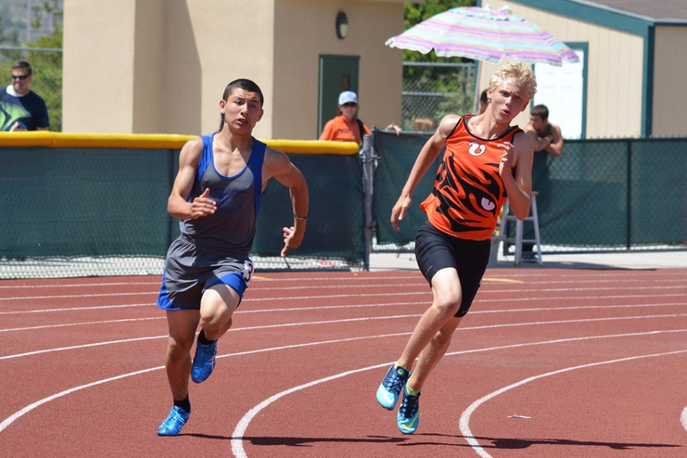Timothy Luna (right) had strong performances earning a spot in the Championship meet in 100 meter dash as well as anchoring the 4X100m relay team.