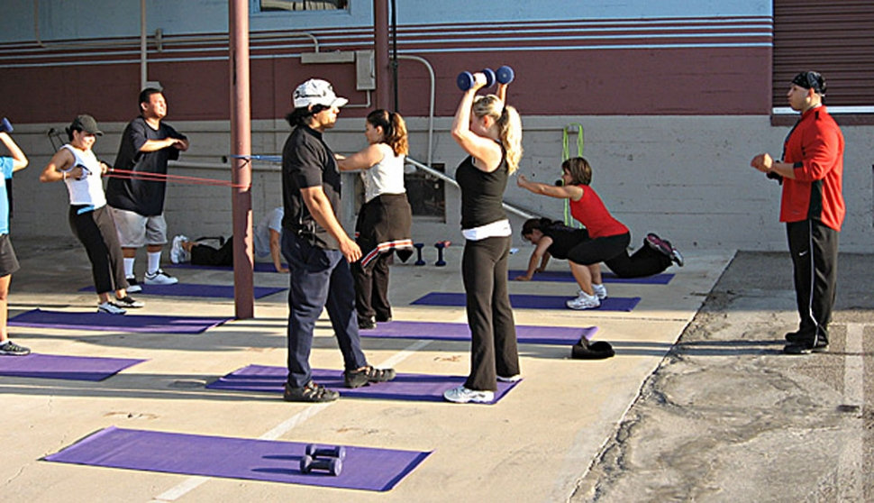 Round three of the Fillmore Fitness Project (Fitness Boot Camp) was held at A Street Storage Friday, July 4, 2008. (Above) Everybody was working hard at getting fit as Fitness Project Director Ivan Chavez corrects form, with Assistant Director Marcos Zuniga (far right) watching carefully.