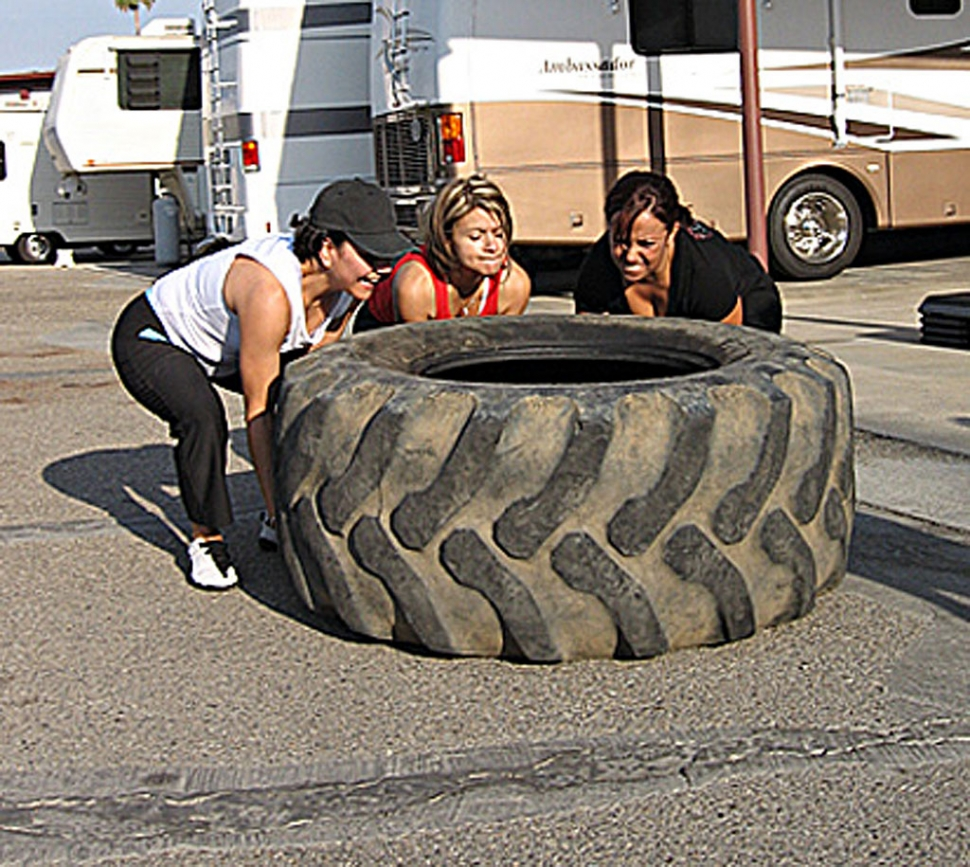 Saving the best for last... ye ole tire toss. These fitness participants are
