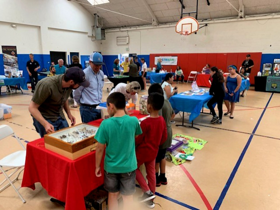 On Friday, July 12th, the Rotary Club of Fillmore participated in the Boys & Girls Club of Santa Clara Valley Kid's Day by cooking hamburgers for 300+ kids, helping with the lunch line and handing out free books. The children are from local communities of Piru, Fillmore and Santa Paula. Thank you to Rotarian and CEO of BGC of SCV Jan Marholin! Not pictured, but in attendance, Rotarian and Fillmore Police Chief Eric Tennessen.Photos courtesy Rotary Club of Fillmore Facebook page.
