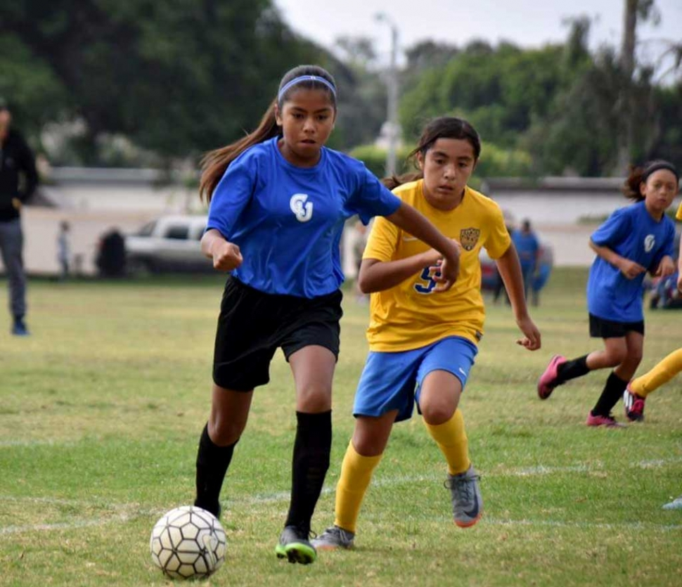 Using her speed, California United's U-11 player Marlene Gonzales runs out ahead of a Wave midfielder.