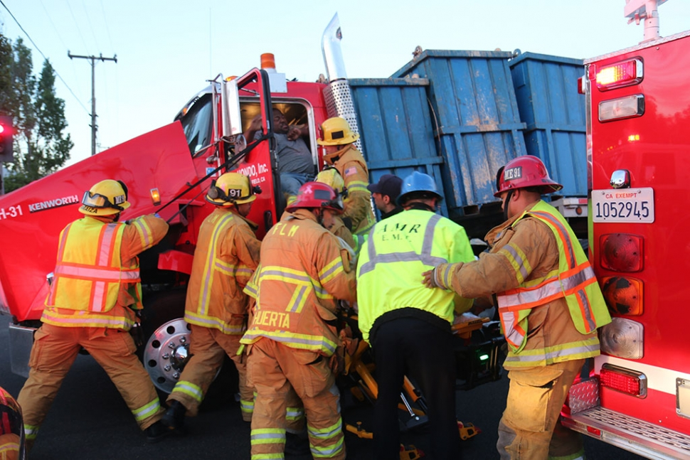 On Sunday morning, August 31, at 6:15am, a Bakersfield-based, HONDO, Inc. 18-wheeler experience a load-shift. The cargo containers appeared to have broken loose from the strapping system, allowing the containers of sulphur to shift forward, crushing the cab. It was reported that each container weighed one ton. The driver was extracted from the cab by Fillmore Fire. As of press time there was no report of his condition. Photos courtesy Sebastian Ramirez.