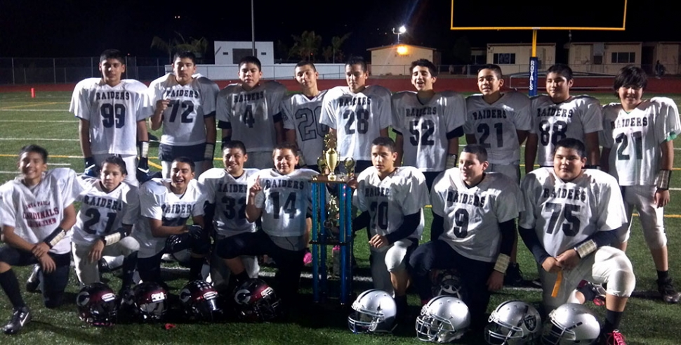 Fillmore Raiders J2, Coached by Head Coach Ralph Meza merged with Santa Paula Cardinal Youth football to form a team and competed in the 12u division. They played two games on Friday to win the championship. First victory was against Santa Ynez 41-0 and second victory was against another Fillmore team 60-48 to win the championship. Pictured (top row) Jose Romero#99, Rafa Meza#72, Daniel Lopez#4, Timmy Luna #26, Pedro Jimenez#52, Victor Jimenez#21, Beto Mejia #88, Daniel Navarro#21. (bottom row) Christian Solis, Aj Gomez, Jordan Ornales, Hugo Virto, Chris Hill, Ricky Holladay, Michael Coronado, Alex Mejia. Not pictured: Head Coach Ralph Meza, Coach Milo Solis, Coach Pete Jimenez, and Coach Troy Eskridge.