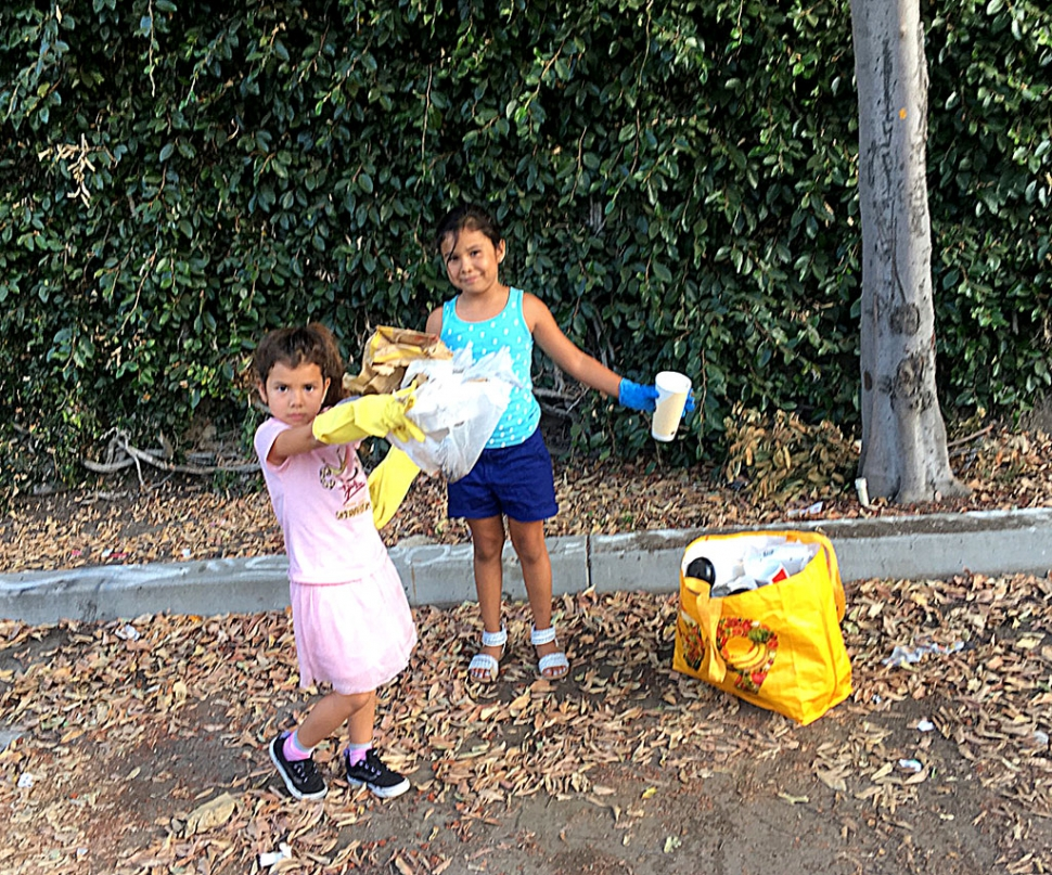 "Fillmore cousins, Alexis Amaro, 7, and Destiny Amaro, 5, are learning about keeping their Fillmore community clean by volunteering to pick up trash that disrespectful people dump in public places. They were seen cleaning up the public parking area east of Central Avenue behind downtown businesses. Hopefully the idea of ""Volunteer Clean Up"" will spread faster than the spreading of trash. Great job girls! You should be proud."