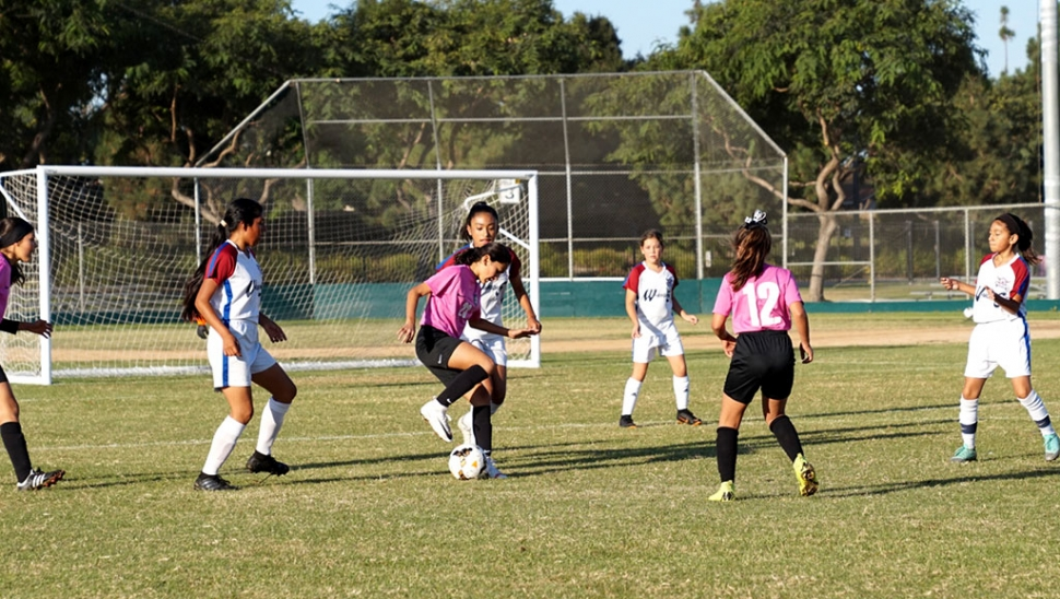 California United's 2008 Girls Bronze Beta's #24 Alondra Leon pulls back the ball as she tries to get past the defense, while #12 Leanna Villa tries to help her teammate. Photos courtesy Susan Torres and Erika Arana.