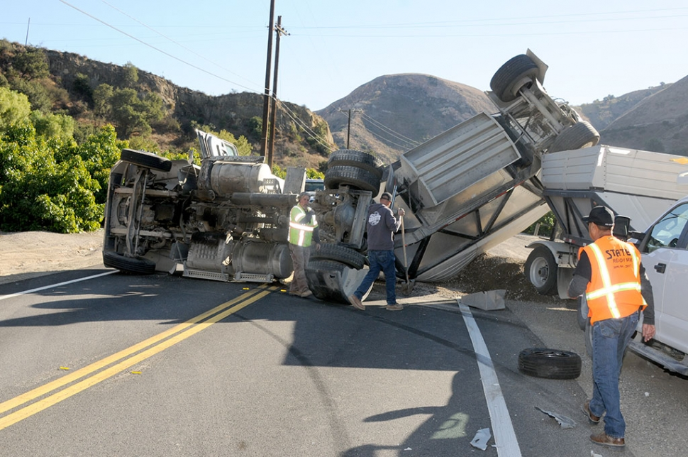 On Tuesday, November 10th at 1:46pm, in the 1700 block of Grimes Canyon Road in Bardsdale, a belly dump truck carrying a full load of gravel, and a grey Toyota Camry collided causing the truck to roll on its side, blocking lanes in both directions. The Camry had severe front-end damage. Cause of the crash is still under investigation. Lanes were to be impacted until possibly 10pm according to the California Highway Patrol.