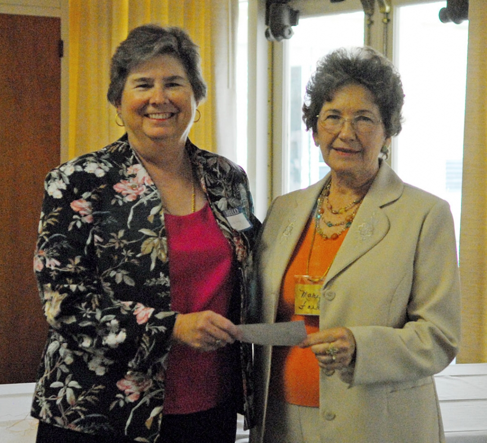 Martha Gentry, President of the Fillmore Historical Society, seen here accepting a $500.00 donation from Fillmore Ebell Club President, Mary Ford.