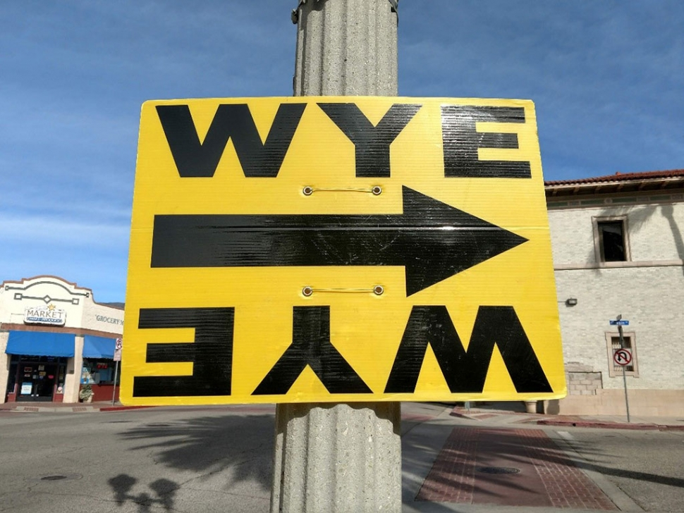 Yellow signs direct the teams to the filming locations.