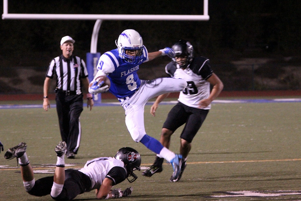 #9 Dominick Gonzalez Leaps over a defender for a first down. Photos courtesy Crystal Gurrola.