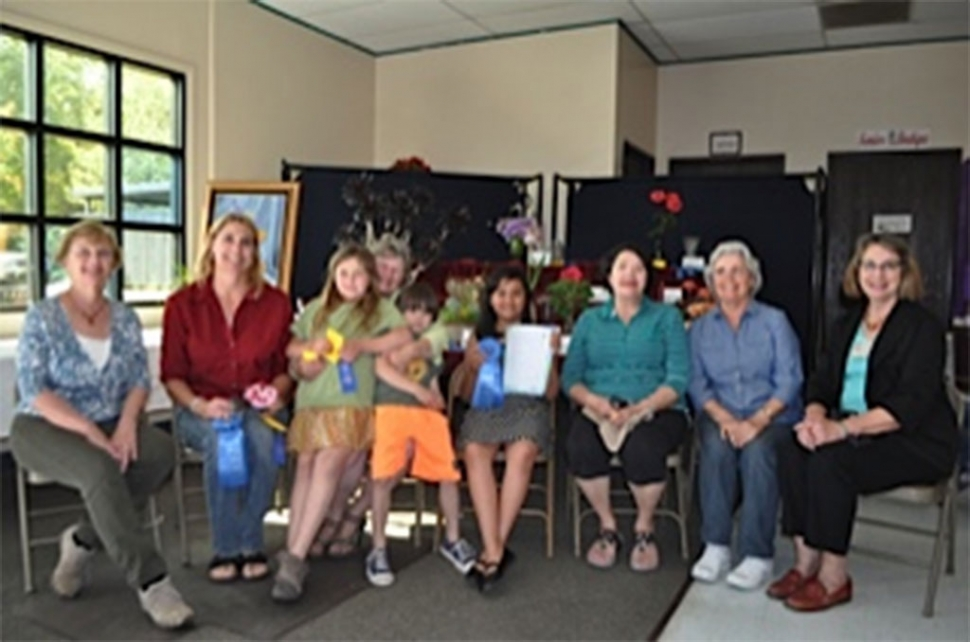 Fillmore Flower Show winners in no order Blanca Martinez, Joy Asenas, Regina Stehley, Carmen Zermeno, Linda Nunes, and Loni Larson.