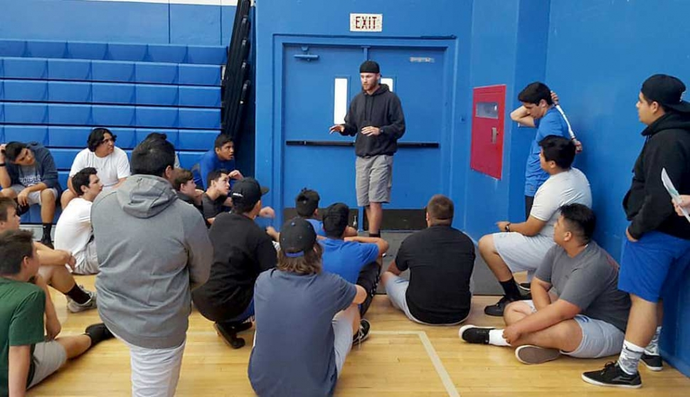 New FHS Head Football Coach Corey Cole addressed the football weightlifting class for the first time as their coach. He spoke of hard work, making football fun again, and a new offense and defense.