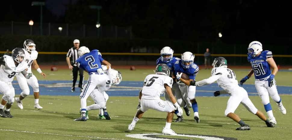 Fillmore's Running Back #20 Ricky Holladay runs past the defense at this past Friday's game