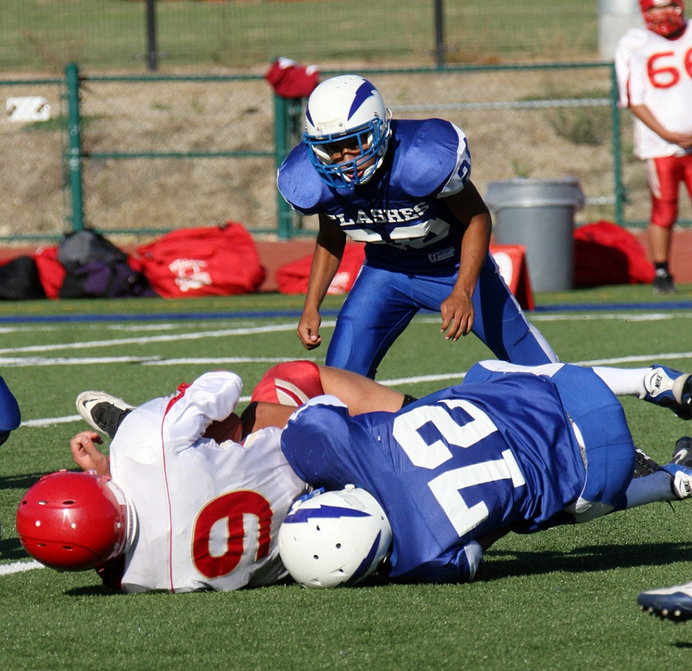 Jeremy Martinez #72 (J.V) tackles Village Christian player #9, during Friday night's football game.