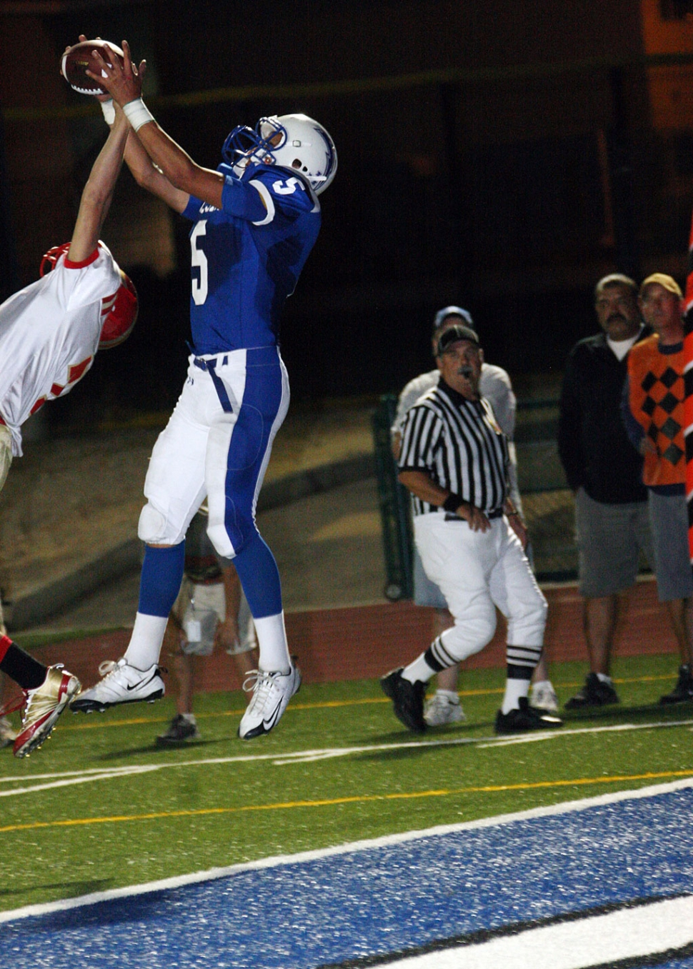 Chris De La Paz jumps to catch a pass thrown by quarterback Corey Cole for a touchdown.