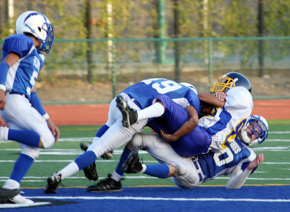 Daniel Cruz #19 (JV) helps his teammate bring a Nordoff runner down. Fillmore lost 42-0.