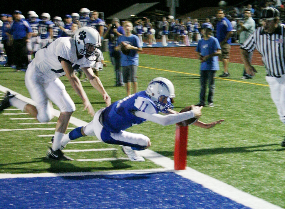 Corey Cole dives into the end zone for one of his three touchdowns. Cole also had 3 passes for 83 yards.