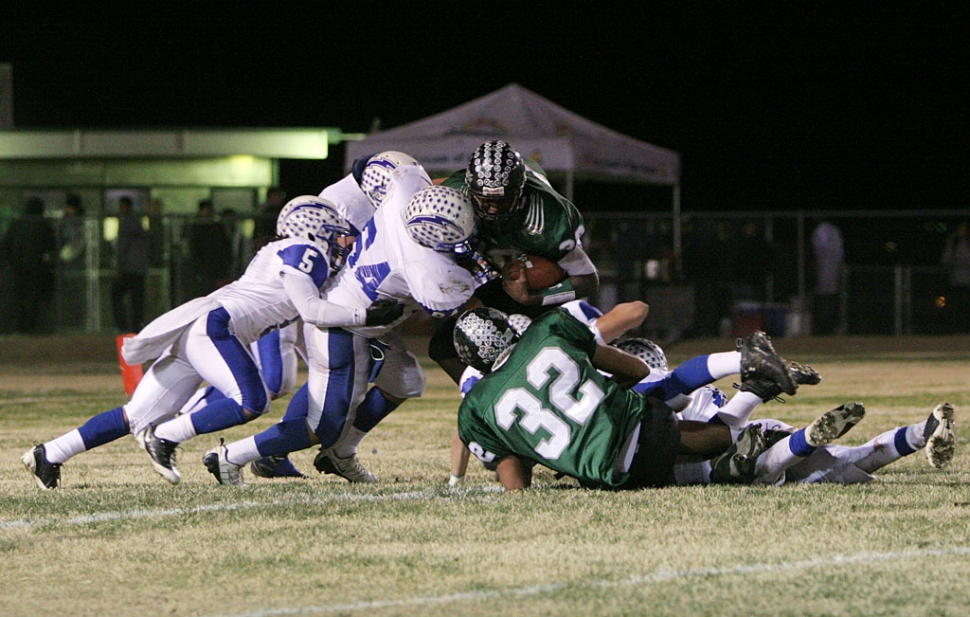 "Troy Hayes #4 and Jose ""Froggy"" Estrada #64 worked together to bring down 29 Palms runningback. Estrada broke a school record for 62 out of 65 PAT attempts."