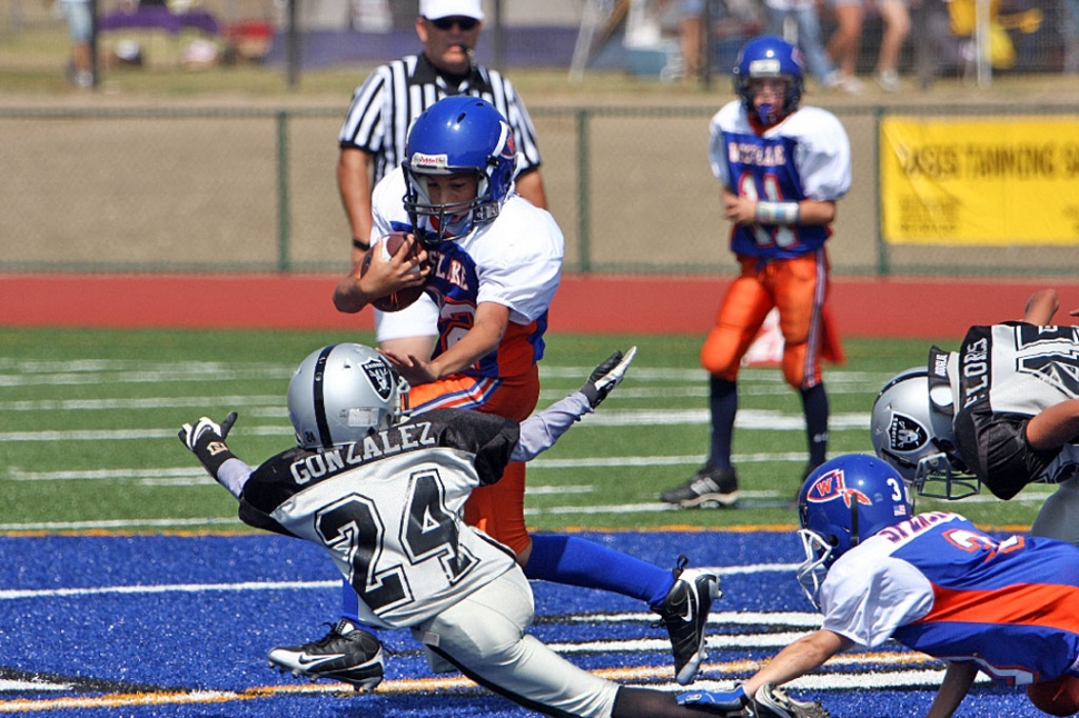 Damian Gonzalez attempts to bring down a Westlake ball carrier.