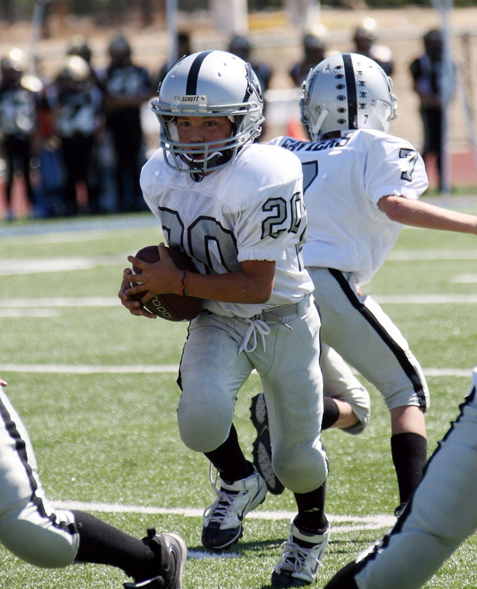 #20, Fillmore Raiders' Bantam team, runs the ball for a few yards at last Saturday's game.