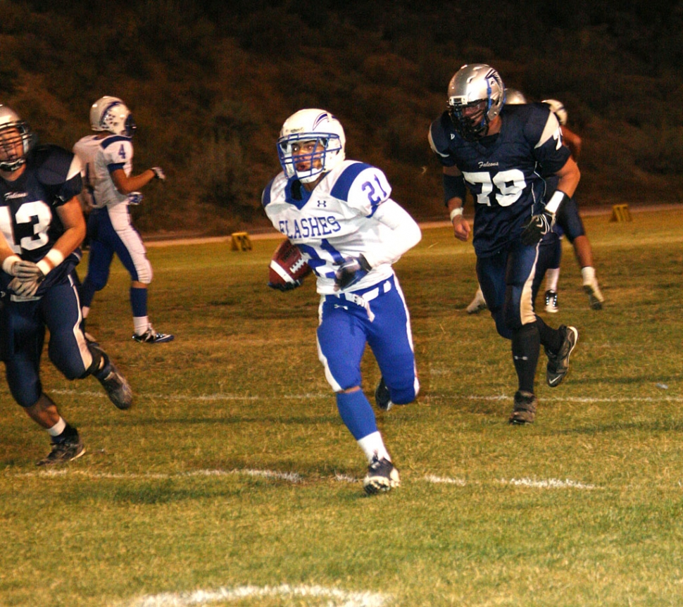 Nick Paz #21 had 8 carries for 71 yards and two touchdowns; one was a 90 yard interception return. (Photos courtesy of Crystal Gurolla)