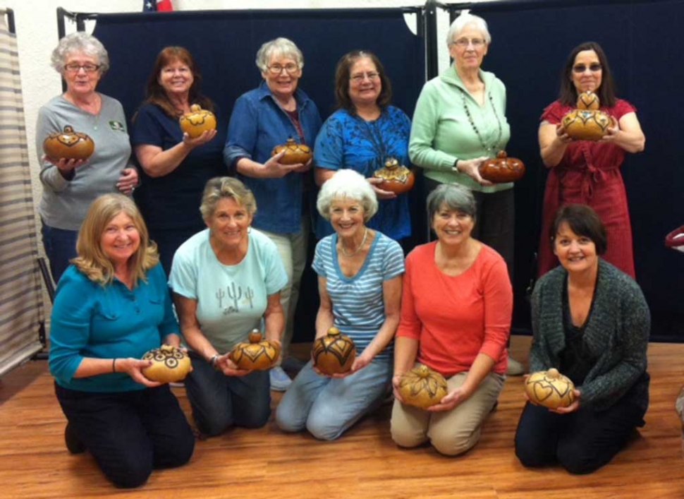 Fillmore Senior Center Gourd Class shows off the Gourds they have been working on. This is an advanced Class Taught by Charlene Smith on the first & third Tuesdays' of the month. Class members are:  Donna Voelker, Diana Hoslett, Shelley Johnson, Colleen Kyffin, Kathleen Johnston, Chris Garcia, Debby Curnett, Jean Westling, Karen Bagley, Lola Rogers, Michele Smith, Nancy Bowlin.
