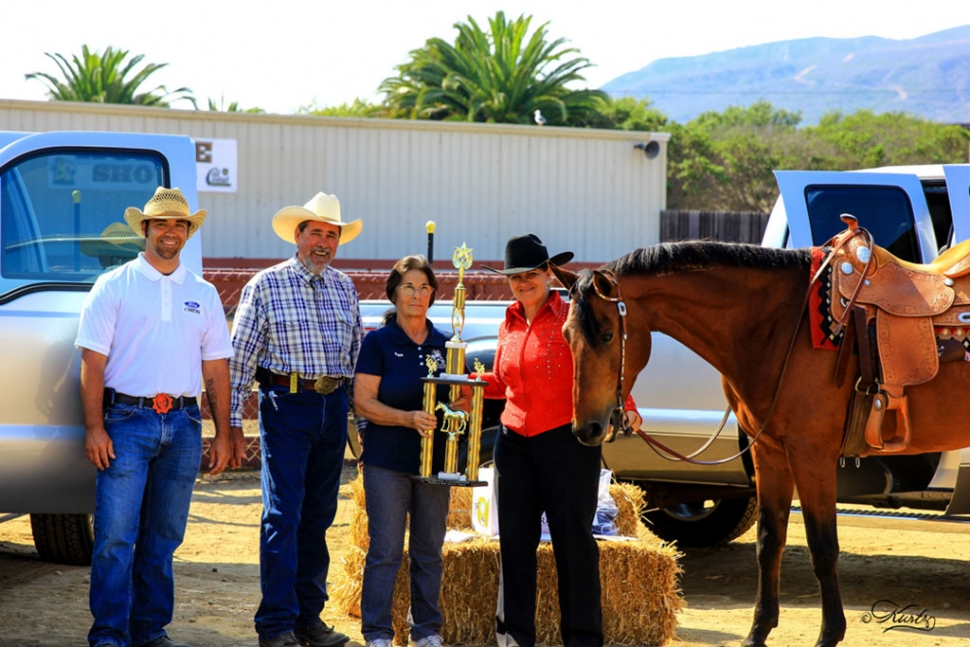 Matt Hardwick & Greg Gustafson of Ford of Ventura, Sue Fleczok of GLAPHC presenting the 2 day championship trophy to Karen Schott of Fillmore with her mustang