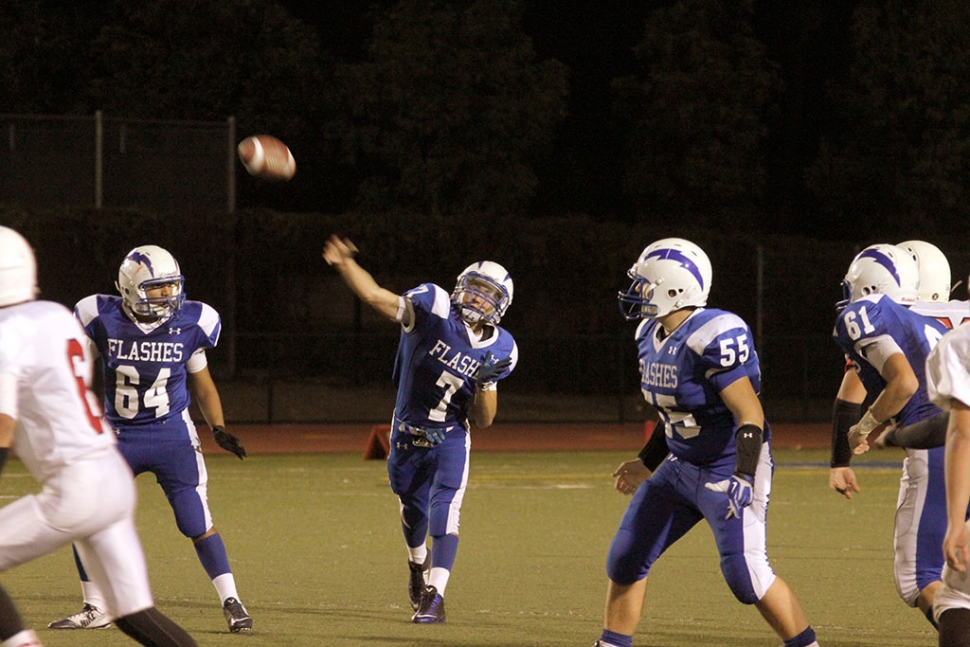 J.V. #7 Hector Sanchez throws a first down pass while being protected by #64 Angel Medina and #55 Michael Morris