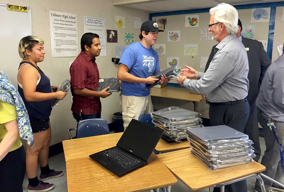Jim Vigdor, Alcoa, Simi Valley, passes out laptops on behalf of the Alcoa Foundation.