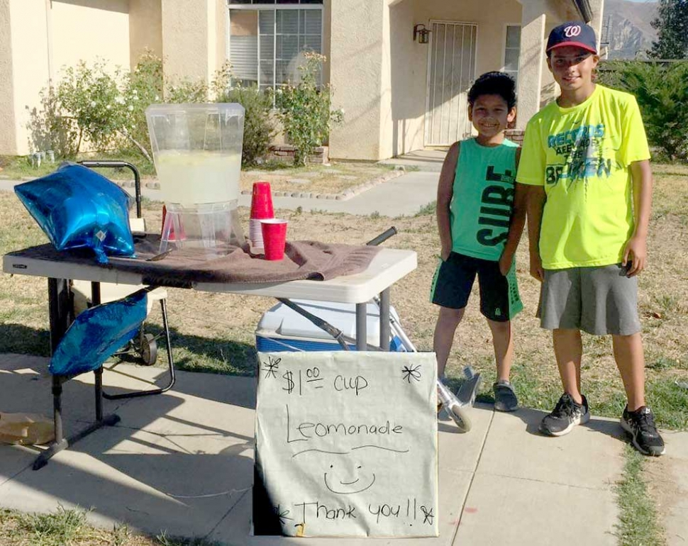 There is nothing better than some fresh lemonade on a hot summer day. Two friends (l-r) AC, 10, and Albert, 11 opened a lemonade stand this week at the corner of River and Central. Just doing their part to help people stay cool during this summer heat wave.