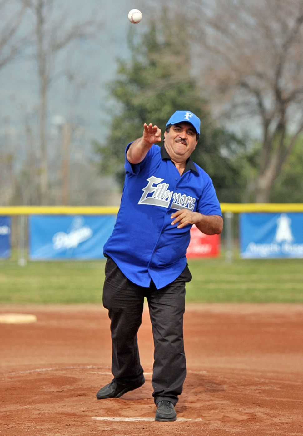 Chuy Ortiz owner of El Pescador restaurant threw out the first pitch during Fillmore Little League's opening ceremonies last Saturday.