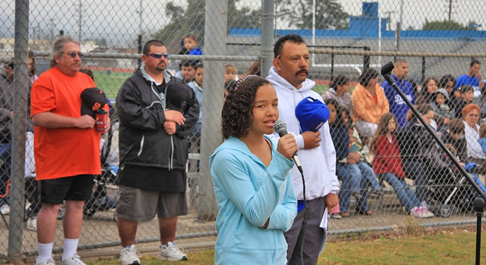 Amber Wilmont sang the National Anthem at Little Leagues opening ceremonies. Also pictured Mickey Wilmont, Armando Tello, and David Lugo.