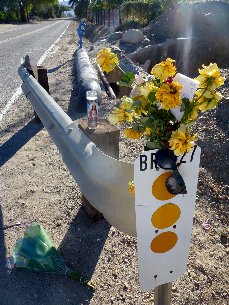 A memorial marks the sight of Saturday night's shooting.