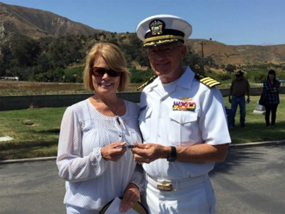 "Debbie Crain Anderson, Class of 71 and wife of Robert (Bob) Anderson, Class of 67 who both grew up in Fillmore and graduated from Fillmore High School presenting Captain Charlie Plumb with the POW bracelet she wore. ""What an honor it was to get the opportunity to meet Captain Plumb. Such an honor. I got the bracelet when we were stationed on Guam when Robert was in the Marine Corps. We had just come from the Philippines. I got a bracelet. I wore it, never taking it off until one night we were watching the news. They were covering a flight of released POW's. As each one walked off the plane their name was called. We got to see Captain Charles Plumb walk off that plane. It was as beautiful and heartwarming then as it was today to get to give him the bracelet that I had not taken off since the day I got it. Our men and women who have served and who serve now, those who suffered in POW camps, our MIA's, those who have come home missing limbs, those who have returned home and those who did not make it home - they are the heroes. They have all paid the ultimate sacrifice. Thank you to them and their families. Let us NEVER FORGET."""