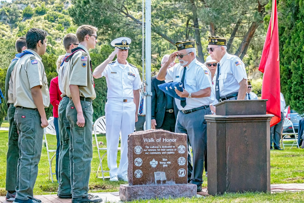 The Bardsdale Cemetery held its Memorial Day Ceremony on Monday, May 27th at 11 a.m. The Ceremony began with a fly-over by the 805th Navion Squadron. Opening remarks were by Lynda Edmonds, Board of Trustees. Pledge of Allegiance by Boy Scout Troop #406, and Cub Scout Troop #3400. This year's featured speaker was Captain Douglas W. King, Civil Engineer Corps, Chief Staff Officer Naval Base Ventura County. Capt. King is a Seabee Combat Warfares Specialist, Warranted Contracting Officer and Acquisition Professional Community member. He has been awarded the Navy Meritorious Service Medal (four awards), Joint Service Commendation Medal, Navy Commendation Medal (four awards), Navy Achievement Medal and other awards. He is married and has three daughters. The Reverend Bob Hammond of St. Stephens Anglican Church gave the Memorial Service, and special music was provided by the Bardsdale Methodist Church Choir, and Cub Scout Troop 3400. Presentation of Colors was Veterans of Foreign Wars, Fillmore Post 9637, Tom Ivey and Ismael Alonzo. Placing of the Wreath by Dmitri Gurkweicz. Also assisting in the ceremony was VFW Post 9637, Boy Scout Troop 406, Cub Scout Troop 3400 and Bob Thompson. The Boy Scouts put out the flags on Friday, May24th, and they were picked up by the Bardsdale 4H on Tuesday, May 28th. Reading of Names of Those Who Died in the Service of our Country was led by Jim Rogers. Taps was by Bill Morris. A special thank you to Garcia Mortuary for furnishing the doves to conclude the service, and to the P.E.O. for furnishing cookies. The Board of Trustees of the Cemetery District is as follows: Gabe Asenas, President, Lynda Edmonds, Secretary, Rita Rudkin, and Kathryn Wren Gavlak; Manager Doug Basolo, staff Damian Foster. Photos courtesy Bob Crum.
