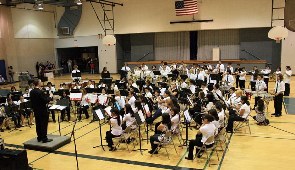 "Fillmore Middle School Band held their spectacular Winter Concert on Wednesday, Dec. 10, 2008, directed by Mr. Greg Godfrey. The first performance was by the 21 Beginning Band students who played short selections from their ""Standard of Excellence"" book. Next, the Intermediate Band members played four rousing marches. These 45 band members are all second and third year musicians. Finally, the 84 members of Advanced Band performed six complex pieces including The Star Spangled Banner , Night on Bald Mountain, and Halo 3. For the grand finale, members of all three groups (shown in attached picture) joined to play Deck the Halls, which they also performed in the Lion's Christmas Parade on Saturday, Dec. 6th. Thanks to the musicians and Director Greg Godfrey for a fantastic performance!"
