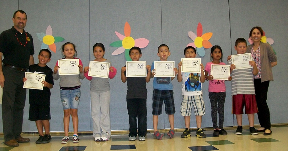3rd Grade Writers and Readers of the Month — Principal Wilber, Angel Gonzalez, Mariah Gonzales, Wendy Bolanos, Carlos Rodriguez, Adrian Aguayo, Cristian Melgoza, Nuviah Vega, Brian Magana, and Board Member Virginia