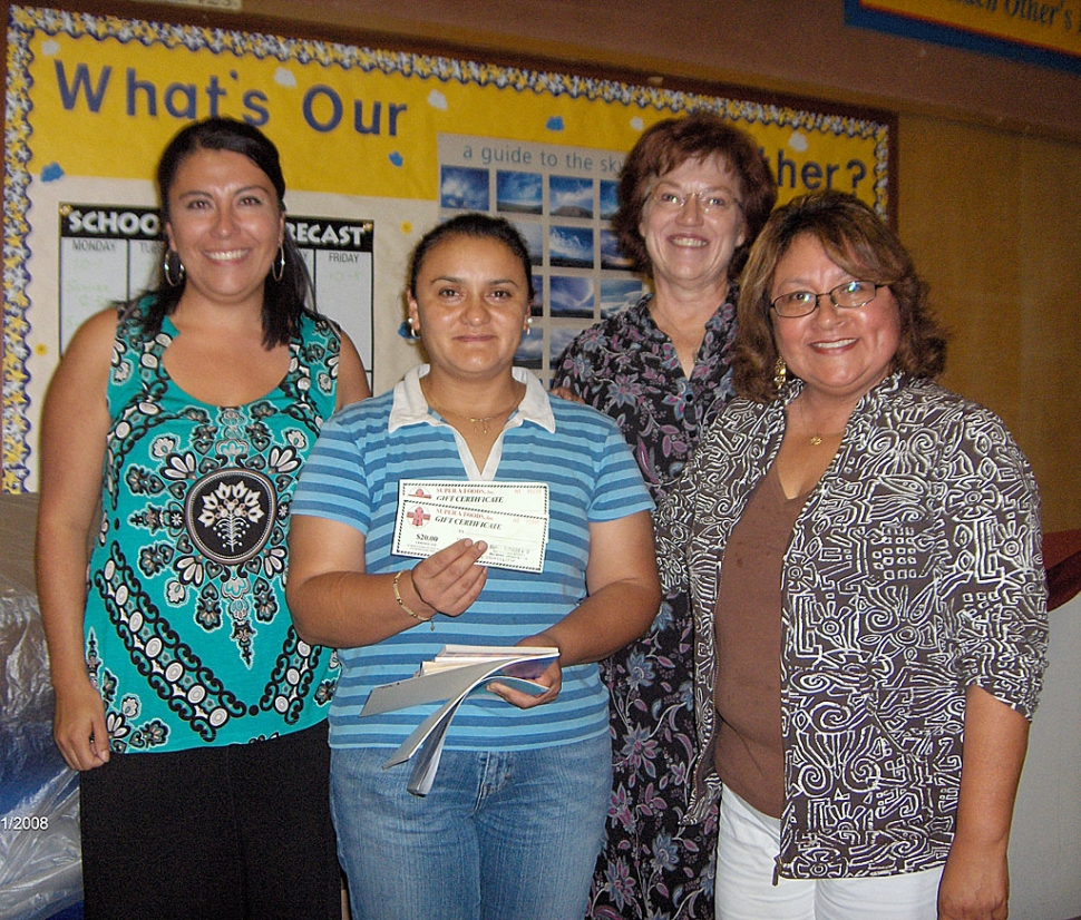 A raffle was held at the end of the Title 1/Migrant Night evening; the prize, a $25 gift certificate for Super A. Pictured are Chrissy Schieferle, Principal of Mountain Vista, Sandra Herrera – the winning parent, Geri Lunde, Principal of Sespe School and Barbara Leija, ELD Coordinator for Fillmore USD. Tricia Gradias, Migrant Education/CBET Coordinator for Fillmore USD and Barbara Leija, ELD Coordinator for Fillmore USD spoke to the Spanish Speaking Parents while Carol Barringer, Fillmore USD Projects Director, presented to the English Speakers.